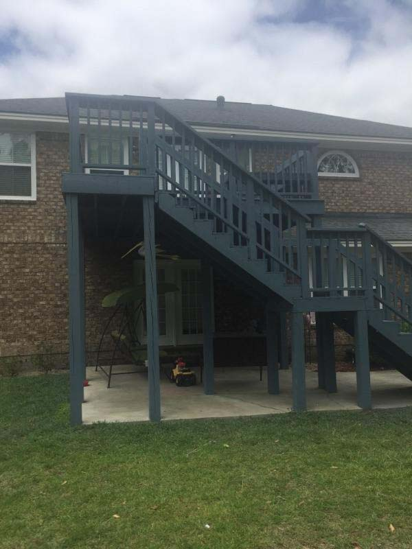 Completed repair and custom railing for deck
